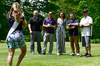 5/23/2019 Mike Orazzi | Staff Miss Connecticut Bridget Oei poses with golfers as Miss Connecticut's Outstanding Teen Morgan Mancini snaps a photograph during the 2nd Annual Miss Connecticut Golf Tournament held at Chippanee Golf Club in Bristol on Thursday.