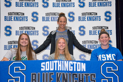 05/23/19  Wesley Bunnell | Staff  Southington High School's softball head coach Davina Hernandez stands behind players Gabriella Verderame-Malachowski,  Chrissy Marotto and Diane Williams.