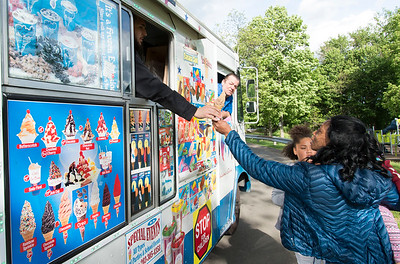 05/24/19  Wesley Bunnell | Staff  Quitta Weaver stops at the ice cream truck with Maliah Rosado, age 10, at Walnut Hill Park on Friday afternoon.