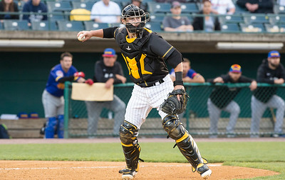 05/24/19  Wesley Bunnell | Staff  New Britain Bees vs the High Point Rockers on Friday night at New Britain Stadium. Catcher Logan Moore (30) throws to first after a dropped third strike.