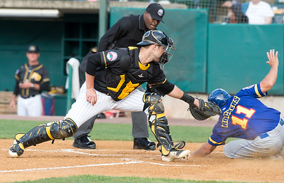 05/24/19  Wesley Bunnell | Staff  New Britain Bees vs the High Point Rockers on Friday night at New Britain Stadium. Catcher Logan Moore (30) attempts the tag on Myles Schroder (11) but the throw as late.