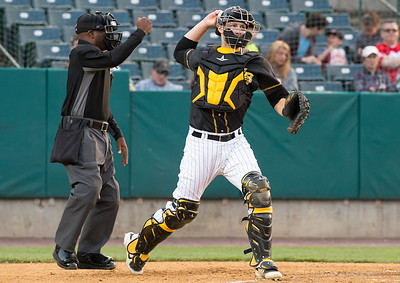 05/24/19  Wesley Bunnell | Staff  New Britain Bees vs the High Point Rockers on Friday night at New Britain Stadium.  Catcher Logan Moore (30) throws down to first base after a called third strike.