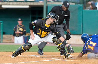 05/24/19  Wesley Bunnell | Staff  New Britain Bees vs the High Point Rockers on Friday night at New Britain Stadium. Catcher Logan Moore (30) receives the throw but it is too late to tag the runner.