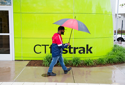 05/28/19  Wesley Bunnell | Staff  Jose Roldan of New Britain walks past the CTfastrak station on a rainy Tuesday afternoon.