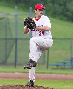 05/28/19  Wesley Bunnell | Staff  Berlin baseball vs Weston in a Class L playoff game which was suspended due to rain after 5 1/3 innings with Berlin up 7-5.  The game is scheduled to begin play again tomorrow at 4pm.  Mark Addamo (24) pitching in relief.