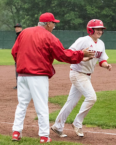 05/28/19  Wesley Bunnell | Staff  Berlin baseball vs Weston in a Class L playoff game which was suspended due to rain after 5 1/3 innings with Berlin up 7-5.  The game is scheduled to begin play again tomorrow at 4pm. Jeff Kuzoian (11) is congratulated by coach Leo Veleas after hitting a two run home run to put Berlin up 7-5.