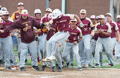 05/29/19  Wesley Bunnell | Staff  Southington defeated New Britain 4-3 in 11 innings on a walk off single by Billy Carr (17) in the continuation of a game suspended in the 10th inning due to rain on May 29th.  Danniel Rivera (1) is mobbed by teammates after hitting a solo home run to temporarily give New Britain the lead.