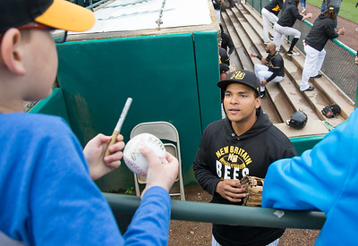 05/03/19  Wesley Bunnell   Staff  The New Britain Bees home opener vs the Somerset Patriots on Friday night at New Britain Stadium.  Jared James (11) looks up at a fan asking for an autograph.