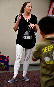 5/4/2019 Mike Orazzi | Staff Children's librarian Christina Carpino directs activities at the Bristol Public Library on Saturday.