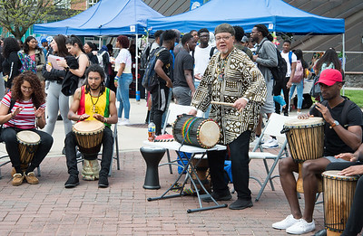 05/6/19  Wesley Bunnell | Staff  CCSU's Africana Center held the Essence Festival on Tuesday afternoon to bring together the community as a whole and support empowerment and understanding amongst groups.  The day featured vendors, food and music for anyone to participate. Lance Kamau, standing, leads a drum circle where anyone could jump in and participate.