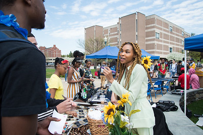 05/6/19  Wesley Bunnell | Staff  CCSU's Africana Center held the Essence Festival on Tuesday afternoon to bring together the community as a whole and support empowerment and understanding amongst groups.  The day featured vendors, food and music for anyone to participate. Designer Couture France, R, discusses her products with students.