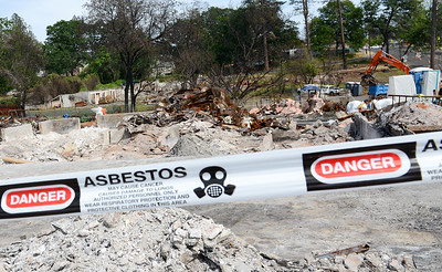 Tape warns of asbestos in a debris filled lot off of Skyway Wednesday in Paradise. (Matt Bates -- Enterprise-Record)