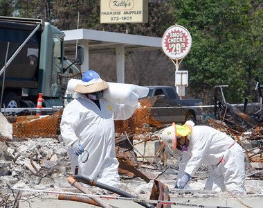 Workers clean up debris off of Pearson Road Wednesday in Paradise. (Matt Bates -- Enterprise-Record)