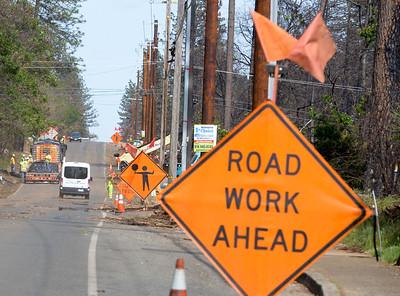Road crews work on Billie Road Wednesday in Paradise. (Matt Bates -- Enterprise-Record)
