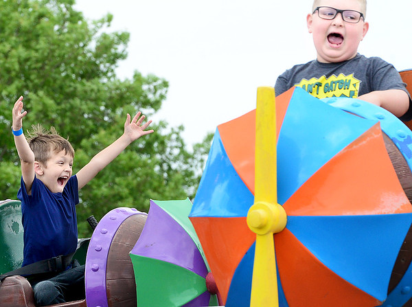 KEVIN HARVISON   Staff photo<br /> Dylan Jackson, far left, reacts while on a carnival ride during the opening of the 2019 Italian Festival Friday.