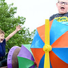 KEVIN HARVISON | Staff photo<br /> Dylan Jackson, far left, reacts while on a carnival ride during the opening of the 2019 Italian Festival Friday.