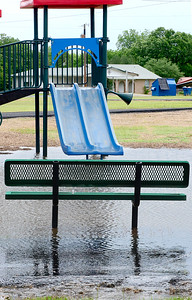 KEVIN HARVISON | Staff photo Water stands in the playground and across the Krebs Walking Track Tuesday after a storm dumped a large amount of rain in a short time in the area.