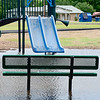 KEVIN HARVISON | Staff photo<br /> Water stands in the playground and across the Krebs Walking Track Tuesday after a storm dumped a large amount of rain in a short time in the area.