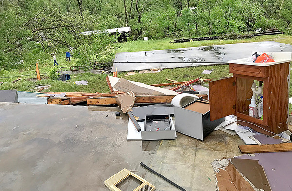 KEVIN HARVISON | Staff photo<br /> Damage from a Haileyville business Wednesday after a tornado tour through town Tuesday night.