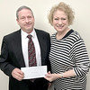 KEVIN HARVISON | Staff photo<br /> The McAlester Chapter Beta Iota of Epsilon Sigma Alpha International presented the First Presbyterian Church a donation. Pictured from left are, Pastor D. Scott Vandenheuvel and Ann Owens.