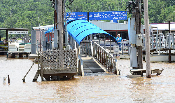 KEVIN HARVISON | Staff photo<br /> A dock at Eufaula Cove on Lake Eufaula is partially underwater.