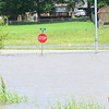 KEVIN HARVISON | Staff photo<br /> A stop sign on Belt Street near Lake Eufaula is partially underwater.