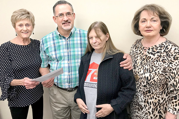 KEVIN HARVISON | Staff photo<br /> The McAlester Chapter Beta Iota of Epsilon Sigma Alpha International presented the Youth Emergency Shelter with a donation. Pictured from left, Betty Balkman, Greg Contreras, Jerrie Contreras and Cinty Pingleton.