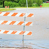 KEVIN HARVISON | Staff photo<br /> A baracade blocks a roadway in Eufaula that is under water.