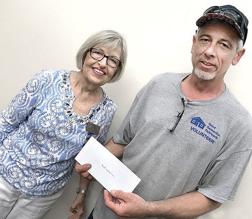 KEVIN HARVISON | Staff photo<br /> The McAlester Chapter Beta Iota of Epsilon Sigma Alpha International presented the Good Samaritan Outreach Program with a donation. Pictured from left are June Miller and Jack Mathis.