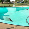 KEVIN HARVISON | Staff photo<br /> McAlester city workers prepare the pool at Jee Lee for the Memorial Day Weekend opening.