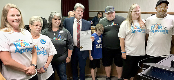 KEVIN HARVISON | Staff photo<br /> McAlester Mayor John Browne read and signed a proclamation for Apraxia during Tuesday's City Counsil Meeting.