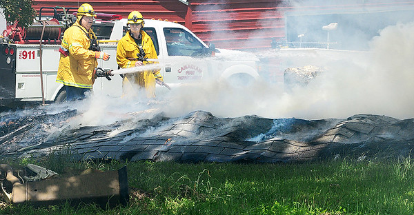KEVIN HARVISON | Staff photo<br /> Canadian and Crowder Fire Departments are photographed on scene of a fire in Crowder Tuesday.