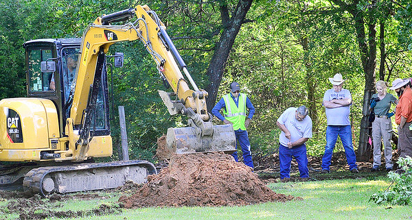 KEVIN HARVISON | Staff photo<br /> <br /> Investigators hope new testing will help identify two bodies involved in a 24-year-old cold case that were exhumed from a rural Pittsburg County cemetery Tuesday.