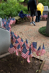 A number of volunteers helped place flags around the Davidson College War Memorial on Memorial Day 2020. [Bill Giduz photo]