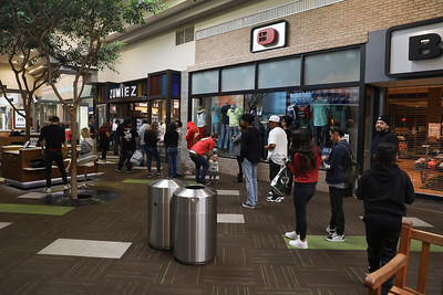 People wait their turn to enter Zumies inside the Chico Mall on Wednesday in Chico. (Carin Dorghalli -- Enterprise-Record)