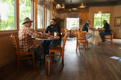 Douglas Broughton and George Ghayi, and Matt Doyle and Weldom Larson have coffee together at Bidwell Perk the day after Gov. Gavin Newsom approved the opening of Butte County restaurants on Wednesday in Chico. (Carin Dorghalli -- Enterprise-Record)