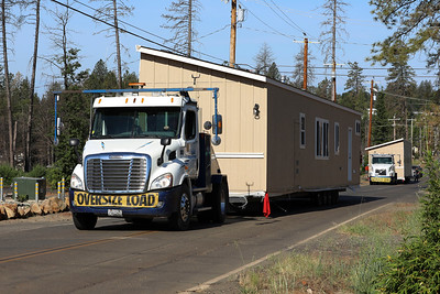 Theresa and Gregory Vincent's new mobile home makes its way to Paradise Mobile Estates, the first mobile home park to open in Paradise since the Camp Fire on Tuesday in Paradise. (Carin Dorghalli -- Enterprise-Record)
