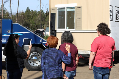Left to right, Toni Hall, Maureen Culleton, Theresa Vincent and Tabitha Alarcon watch as Vincent's new mobile home arrives at Paradise Mobile Estates, the first mobile home park to open in Paradise on Tuesday. (Carin Dorghalli -- Enterprise-Record)