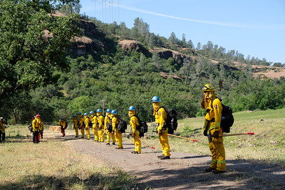 A California Conservation Corps wildland firefighting crew practices getting out their tools Tuesday in a Cal Fire-Butte County exercise near Richardson Springs. (Camille von Kaenel — Enterprise-Record)