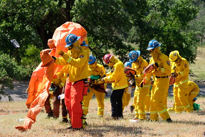 A California Conservation Corps wildland firefighting crew practices deploying fire shelters, which are a last-resort option to protect against radiant heat in the case of an approaching fire, in a Cal Fire-Butte County exercise near Richardson Springs on Tuesday. (Camille von Kaenel — Enterprise-Record)