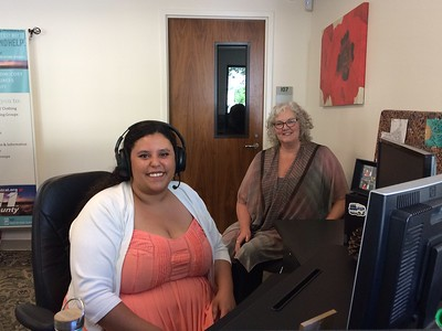 Help Central Executive Director Tara Sullivan-Hames (background) talks with call specialist Rina York about helping  residents of Butte and Glenn counties by calling 2-1-1. (Laura Urseny -- Enterprise-Record)