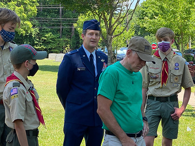 Recently retired Air Force Colonel Aaoron Steffens joined his two scouts sons at Mimosa Cemetery for the Flags In even to place flags at the graves of Veterans buried in the three cemeteries across town.