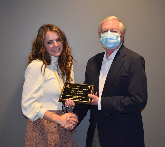 Sterling Rotary Club President Dennis Foxhoven presents the Highest Academic Average Award to Alyssa Sprague  at Northeastern Junior College's Associate Degree Nursing Pinning Ceremony Thursday, May 13, 2021.