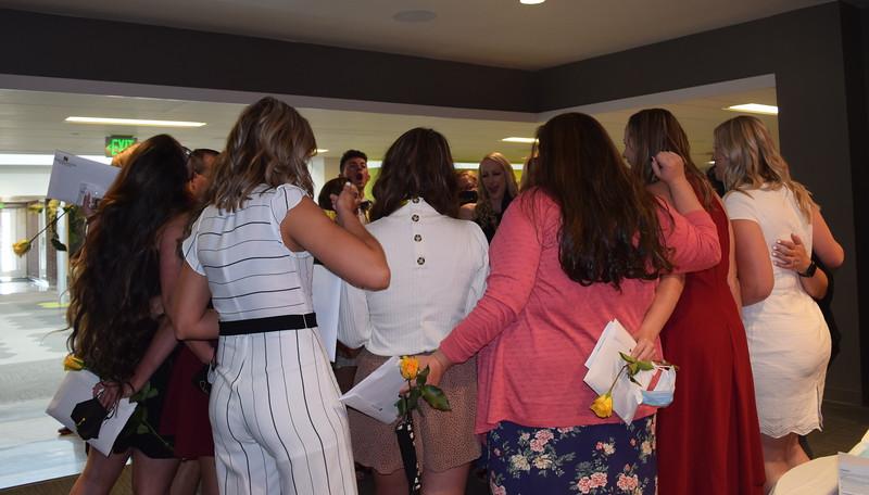 Northeastern Junior College nursing graduates huddle together in celebration following the Associate Degree Nursing Pinning Ceremony Thursday, May 13, 2021.