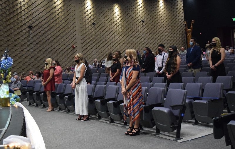 Graduates wait to be seated as the start of Northeastern Junior College's Associate Degree Nursing Pinning Ceremony Thursday, May 13, 2021.