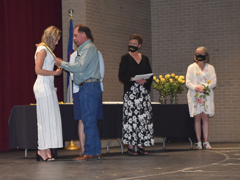 Madison Blackwelder is pinned by her father at Northeastern Junior College's Associate Degree Nursing Pinning Ceremony Thursday, May 13, 2021.