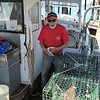 SEAN HORGAN/Staff photo/Joe Mondello, as with many lobstermen at docks around Gloucester and the rest of Cape Ann, wasted little time getting back to work after the state lifted a ban on lobster trapping on Friday.
