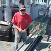 SEAN HORGAN/Staff photo/Joe Mondello,71, was up at 6:30 Friday morning to begin setting his lobster traps after the state lifted a ban on trap fishing in state waters