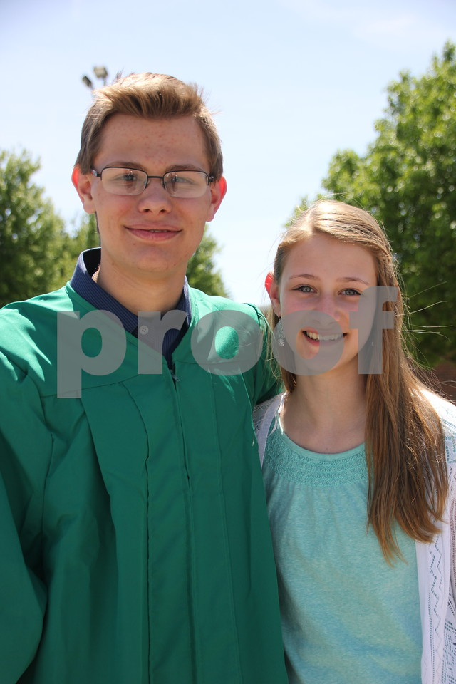 Pictured left to right is: Jacob Ulicki, a graduate, with Chloe Ulicki,  attending the graduation for Saint Edmond High School which held commencement on Sunday, May 22, 2016 at the Saint Edmond High School in Fort Dodge.
