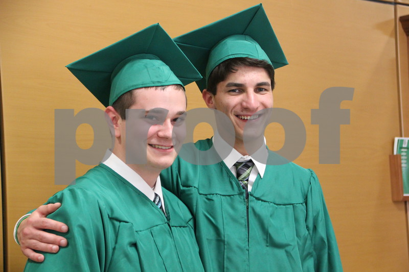 Seen left to right is: Ethan Li and Nick Lenane, both graduates, of Saint Edmond High School which held commencement on Sunday, May 22, 2016 at the Saint Edmond High School in Fort Dodge.